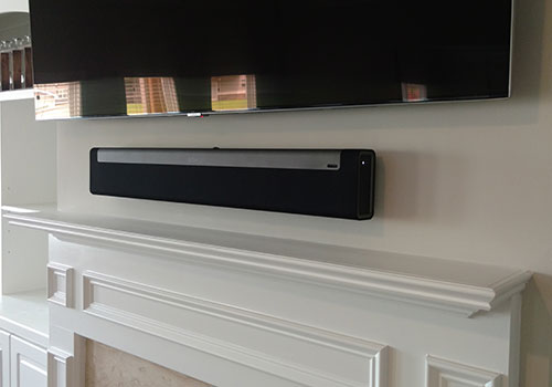 TV and Sonos Playbar Mounted Over Fireplace